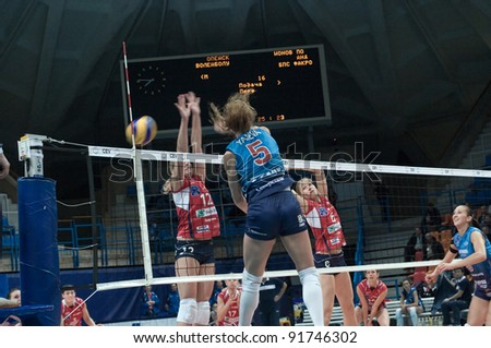 MOSCOW, RUSSIA - DECEMBER 8: Unidentified players in action a European League woman's volleyball game Dynamo Russia (blue) vs Bank BPS Mushin Poland (red) on December 8, 2011 in Moscow, Russia.