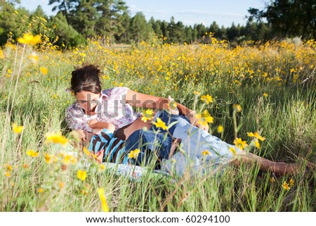 Mother breast feeding her baby boy outdoors - stock photo
