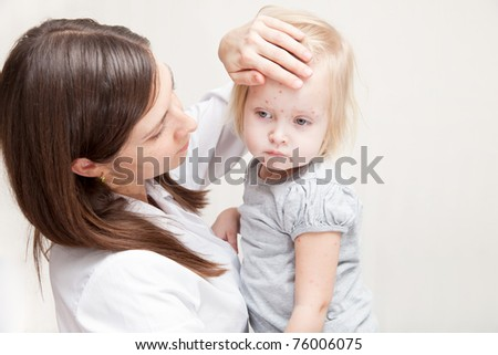 mother is holding a sick daughter in her arms - stock photo
