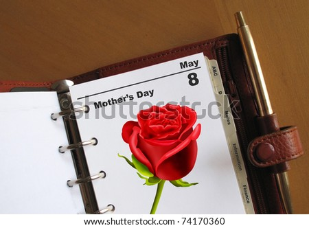 Mother's day diary date in a personal organizer with a rose and blank space for your own text - stock photo