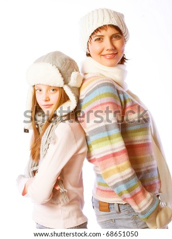mother with child in winter  hats - stock photo