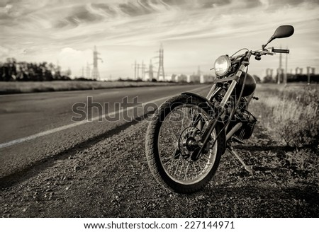 Motorbike.Road and city with open sky on background.Vintage effect added  - stock photo
