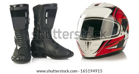 Motorcycle red and white helmet and black leather boots isolated on white background - stock photo
