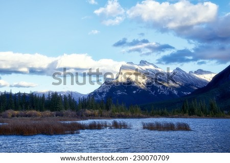 """""""Mount Rundle"""" Early October evening enjoying Mount Rundle (9,672') from the Vermilion Lakes, just outside the town of Banff, Alberta. - stock photo"""