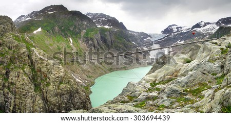 Mountain landscape with Trift Bridge and lake Trifsee. Switzerland