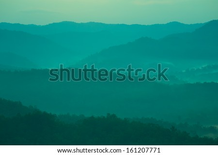 Mountains and fog - stock photo
