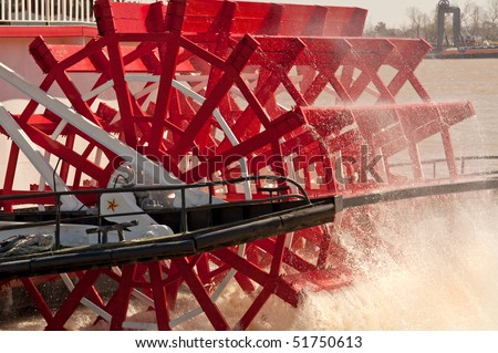 Movement of water by riverboat paddle wheel - stock photo