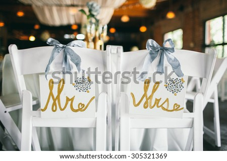 """""""Mr. & Mrs."""" Wedding Bride and Groom Signs at Reception - stock photo"""