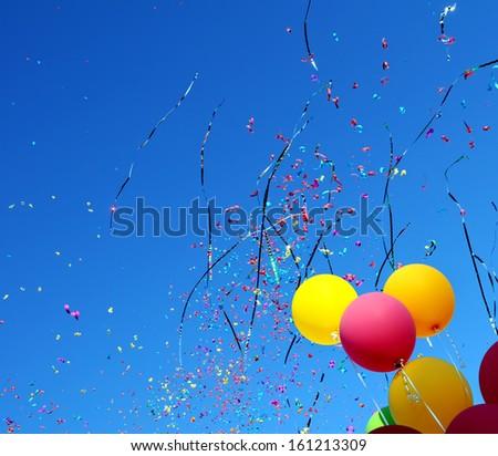 multicolored balloons and confetti in the city festival #10 - stock photo