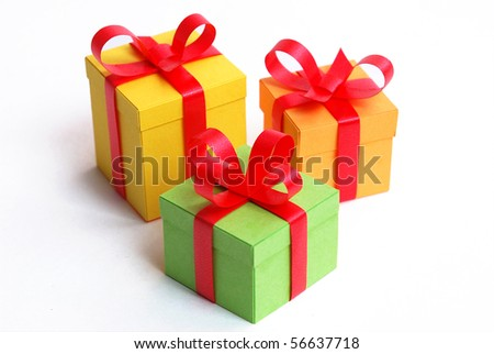 3 multicolored presents with red bowknot - stock photo