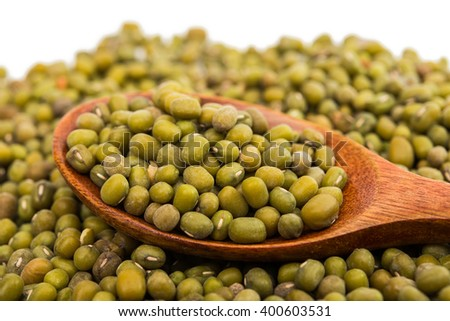 Mung Beans in wooden spoon isolated on white background