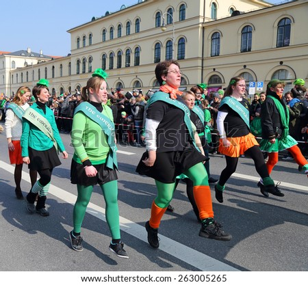 MUNICH - MARCH 15: irish dancers march at St. Patrick's day on March 15, 2015 in Munich, Germany. This national Irish holiday takes place annually in March in Dublin and other European cities. - stock photo
