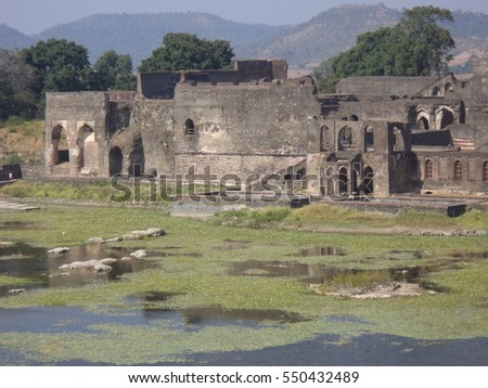Munj Talao with the ruins of the former palaces and champa baodi at Jahaz Palace, Mandu, Madhya Pradesh, India