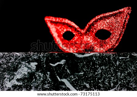 ,mysterious mask and theatrical red setting, - stock photo