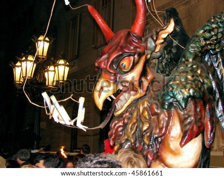 mystical figure of a devil on celebratory procession San Juan in barcelona, spain