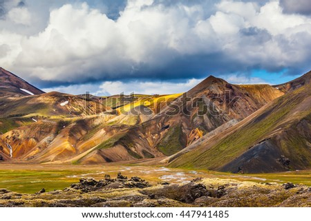 National Park Landmannalaugar. Multicolored rhyolite mountains of the July sun lit. Travel to Iceland in the summer - stock photo