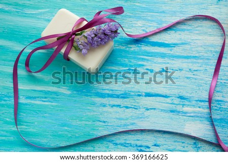 natural organic soap with flowers on a blue wooden table, birthday, women's day, mockup, text, note, notebook, texture - stock photo
