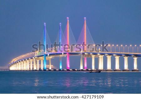 2nd Penang Bridge Light up during blue hour - stock photo