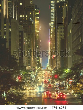 42nd Street in New York City with Grand Central and Times Square in the distance, focus in mid area of image with retro filter - stock photo