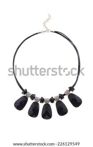 necklace with black stone on a white background - stock photo