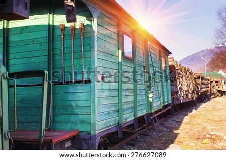 Network of narrow-gauge railway was built in the Carpathian region in the late XIX century. In Kolochava on the tracks should train consisting of a locomotive and ten passenger - stock photo