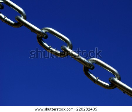 new chain is isolated on a dark blue background - stock photo