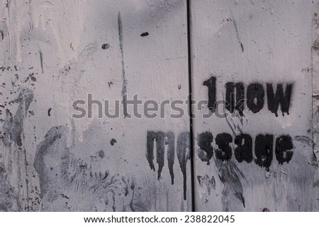 """1 new message"" scribbled on a wooden white wall - stock photo"