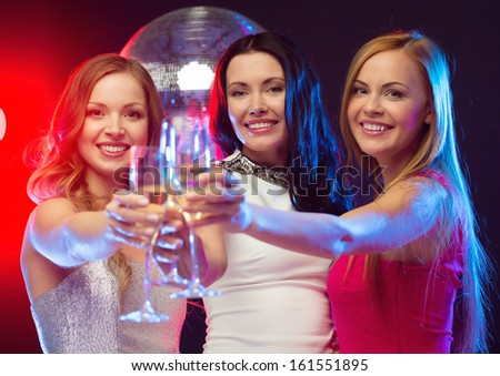 """new year"", celebration, friends, bachelorette party, birthday concept - three beautiful woman in evening dresses with champagne glasses"
