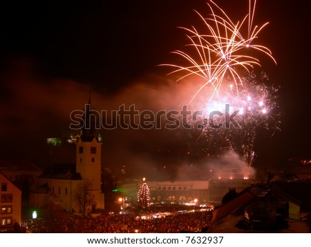 New year celebration with fireworks in the centre of town - stock photo