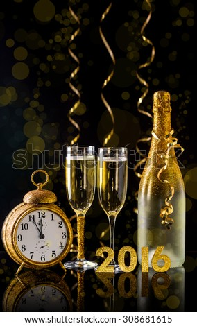 2016 New Year concept with two champagne glasses ready to bring - stock photo