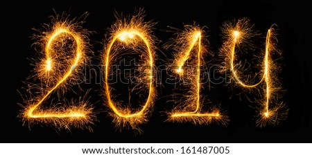2014 New Year - figures made of sparklers (Bengal fires) - stock photo