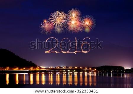 2016 New Year Fireworks celebrating over Lake Kawaguchiko at night with mount Fuji background, Japan - stock photo