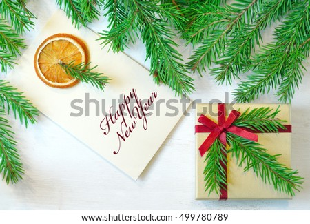 "New Year gift, envelope with  inscription ""Happy New Year"" christmas tree branches. Overhead view.  New Year mood photo"