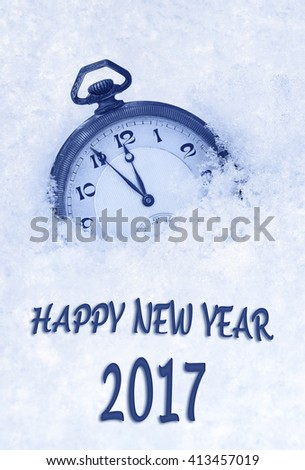 2017 New Year greeting card  in English language, pocket watch in snow, 2017 new year - stock photo