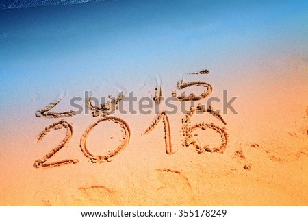 New Year 2016 replace 2015 concept writing sand on the sea beach - stock photo