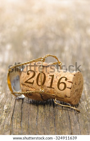 new year 2016 with cork of champagne on wooden plank