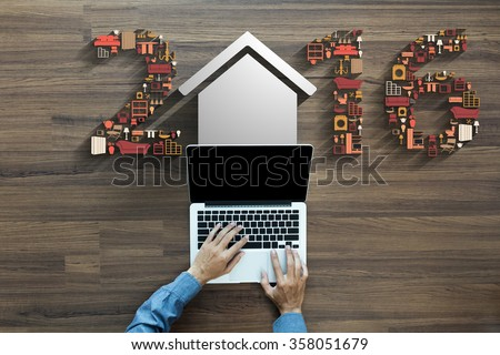 2016 new year with flat design concepts home appliances icons, With businessman working on laptop computer PC on wood table, view from above - stock photo