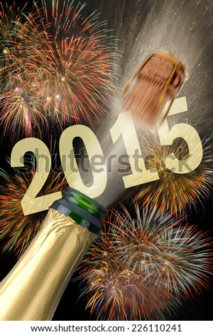 new year 2015 with popping champagne and firework - stock photo