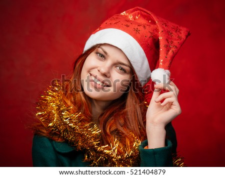 New Year. Woman in New Year's cap. Beautiful woman in tinsel