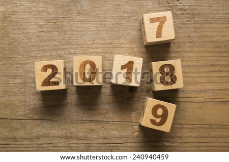 2018 New Year wooden cubes on a wooden background - stock photo
