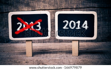 2014 new year. Writing with chalk on a blackboard  - stock photo