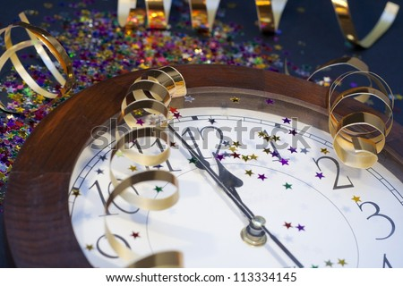 2012 New Years Party Background. Clock and festive tinsels - stock photo