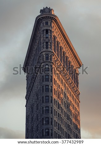 NEW YORK CITY - Nov 10: Historic Flatiron Building in NYC as seen on November 10, 2016. This iconic triangular building located in Manhattan's Fifth Ave was completed in 1902 - stock photo
