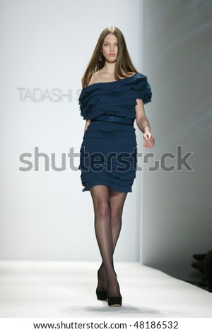 NEW YORK - FEBRUARY 15: A model is walking the runway at the TADASHI SHOJI Collection for Fall/Winter 2010 during Mercedes-Benz Fashion Week on February 15, 2010 in New York. - stock photo