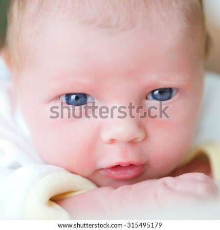newborn baby on a blanket - stock photo