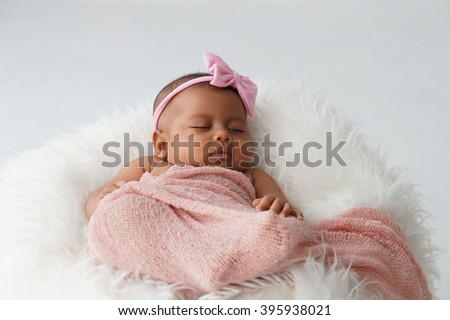 Newborn baby sleeping, soft focus, shallow DOF