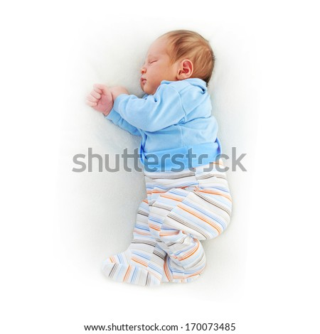 Newborn cute baby sleeping on white blanket - stock photo