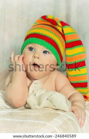 newborn, little baby, boy in a cap - stock photo