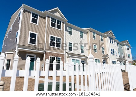 Newly build townhouses with vinyl siding - stock photo