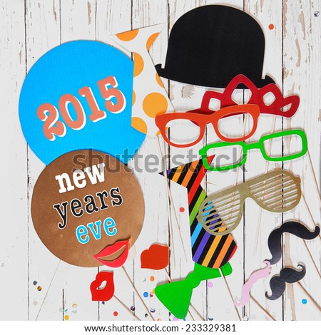 2015 News Years Eve carnival background with comic colorful photo booth paper fashion accessories for a fun party disguise - stock photo